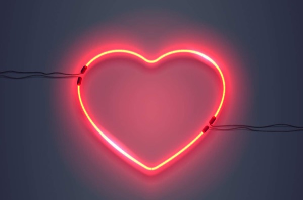 A neon light in the shape of a heart