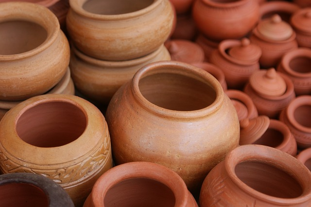 A bunch of ceramic pots. Image by johannatherealtor on Pixabay.